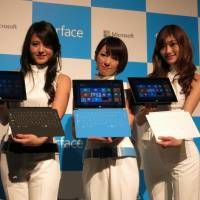 Model behavior: Microsoft Corp.'s Surface RT tablet computers and attachable keyboards are unveiled at a media event in Tokyo on Friday. | KAZUAKI NAGATA