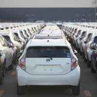 Outbound: Toyota Motor Corp. Aqua hybrid compacts await shipment at the port of Sendai in December. | BLOOMBERG