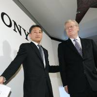 The old and the new: Sony Corp. Chairman Howard Stringer and Kazuo Hirai, who succeeded him as president and CEO last April, leave a news conference in Chiyoda Ward, Tokyo, in February 2012. Stringer announced Friday that he will retire in June. | KYODO