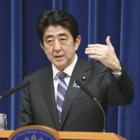 Outdoing himself: Prime Minister Shinzo Abe responds to a question during a press conference on Monday. | KYODO
