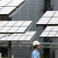 Sunny side up: Japan's proposal to cut the price paid for solar power by 10 percent leaves in place incentives for a boom in installations this year, according to an advisory group to the Ministry of Economy, Trade and Industry. | BLOOMBERG
