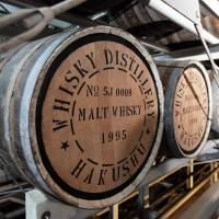 Barrel vault: Casks of malt whisky sit in a warehouse at Suntory Holdings Ltd.'s Hakushu distillery in Hokuto, Yamanashi Prefecture, last May. Suntory Holdings plans to list its core subsidiary on the Tokyo Stock Exchange to raise more funds. | BLOOMBERG