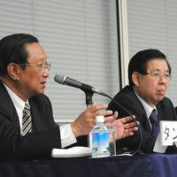 Than Lwin (left), deputy chairman of the Kanbawza Bank, speaks about financial sector reforms in Myanmar while co-panelist Zaw Min Win, vice president of Myanmar's Federation of Chambers of Commerce and Industry, listens during a March 7 symposium held in Tokyo. | SATOKO KAWASAKI