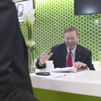 Currency imbalance: Ford Motor Co. President and CEO Alan Mulally prepares for a television interview at the Bloomberg office in Bangkok on Tuesday. | BLOOMBERG