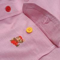 Detail of The King of Games Mario dress shirt.