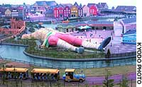 A giant Gulliver lies pinned to the ground in Fuji Gulliver's Kingdom in Kamikuishiki, Yamanashi Prefecture.