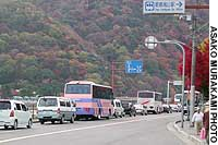 A road leading to the Arashiyama district from the center of Kyoto is clogged with traffic as tourists come to view the area's famous autumn leaves.