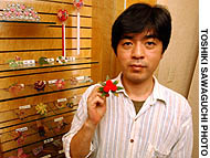 Tsuyoshi Ishida shows one of the ornaments at the Tsunami-Kanzashi Museum in Takadanobaba in Tokyo.
