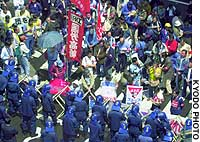 Police keep protesters out of a building in Tokyo where the National Railways Union was holding an extraordinary convention.
