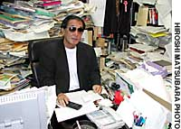 Yasunori Okadome, chief editor of monthly magazine Uwasa-no-shinso (The Truth Behind the Rumors), sits in his office in Tokyo's Shinjuku Ward.