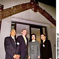 The New Zealand Embassy  in Tokyo debuts a traditional Maori entryway Wednesday in a ceremony marking 50 years of bilateral relations attended by (from left) Paratene Te Huia, New Zealand Ambassador Phillip Gibson, Justice Minister Mayumi Moriyama and Chansuda Gibson.