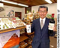 Sadaichi Osada, director of the Tokyo office of the Yamanashi Prefectural Trade and Tourist Center, displays a range of local products, including wine, which the center hopes to start selling in December.