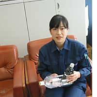 Police sgt.  Makiko Miyazaki, of the Kagawa Prefectural Police, shows off the equipment that helped her develop a new way of taking fingerprints.