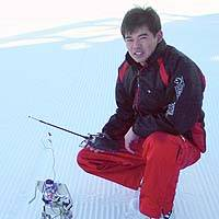 Masaya Takahashi shows off the skiing robot he developed at a ski resort near Nagoya. | PHOTO COURTESY OF MASAYA TAKAHASHI