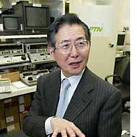 Alberto Fujimori speaks during an interview at the Tokyo office of the Associated Press.