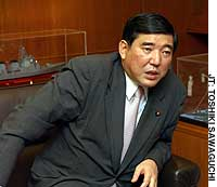 Defense Agency chief Shigeru Ishiba shares his views at his office in Shinjuku Ward, Tokyo.