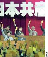 Senior officials of the Japanese Communist Party approve a new policy platform Saturday at their convention in Atami, Shizuoka Prefecture.
