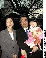 Satoru Ieinishi with his wife, Chikako, and their 3-year-old daughter, Reina.
