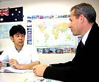 Tsuneto Onozawa chats with his English teacher, Deane Hamilton, at a language school in Tokyo.
