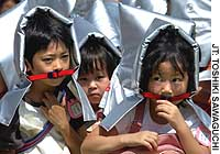 Schoolchildren wear protective hoods during an earthquake drill at Bancho Elementary School in Chiyoda Ward, Tokyo.