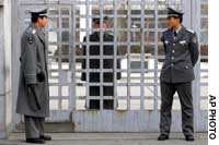 Beijing- Chinese security guards stand outside a Japanese school here Friday morning after seven apparent North Korean asylum-seekers entered the compound.