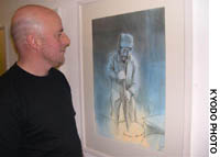 Artist Geoff Read views one of his drawings earlier this month at an exhibition in London featuring homeless people in Britain and Japan.
