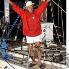 Nonstop circumnavigator, 71, sails into record books
