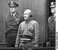 Wartime Prime Minister Hideki Tojo listens as his death sentence is read aloud on Nov. 12, 1948, at the International Military Tribunal for the Far East.
