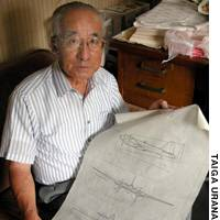 Retired engineer Jiro Tanaka shows designs for the Ki-74 bomber at his home in Shibuya Ward, Tokyo.