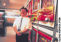 Tetsuo Makino, manager of a pachinko museum in Taito Ward, Tokyo, shows off the game machine collection earlier this month.