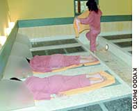 Women lie on bedrock slates at a popular bathhouse in Sapporo.