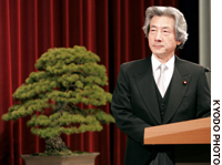 Prime Minister Junichiro Koizumi faces reporters at the Prime Minister's Official Residence.