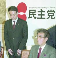 Democratic Party of Japan leader Seiji Maehara (left) and the DPJ's newly appointed Diet affairs chief, Kozo Watanabe, attend a gathering of the opposition party's Diet members at the Diet on March 3.