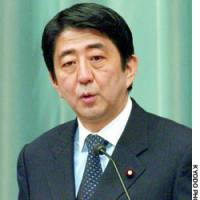 Chief Cabinet Secretary Shinzo Abe responds to questions regarding the previous day's plebiscite in Iwakuni, Yamaguchi Prefecture.