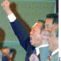 Ichiro Ozawa acknowledges the crowd as he is elected president of the Democratic Party of Japan in Tokyo on Friday.