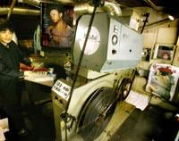 Junpei Shinno, a 26-year-old screen technician, works in the projection room at Shinbashi Roman Theater, which specializes in soft-core pornographic movies, near JR Shinbashi Station in Minato Ward, Tokyo.