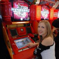 Jenn Barr, one of the pro mahjong players appearing in Konami's 'Mahjong Fight Club' game for arcades and the Sony PlayStation, shows off her style at a Tokyo game center.
