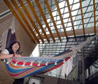 Yuuki Aoya, 24, tries out a hammock at a Tokyo event Friday under the theme of LOHAS, which stands for 'Lifestyles of Health and Sustainability.'