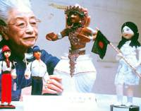 Tenkoko Sonoda looks at some of the 'peace ambassador dolls' sent by 57 countries. | PHOTO COURTESY OF YOICHI YAMAZAKI