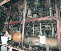 Members of the media scrutinize Aum Shinrikyo's sarin gas plant in Kamikuishiki, Yamanashi Prefecture, in September 1998. The plant was later scrapped. The village of Kamikuishiki was merged into neighboring municipalities and no longer exists.