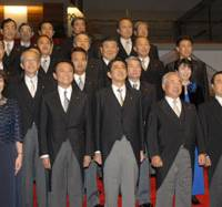 Prime Minister Shinzo Abe (front row, third from right) poses with his Cabinet at the Prime Minister's Official Residence after an attestation ceremony at the Imperial Palace on Tuesday evening. | YOSHIAKI MIURA PHOTO