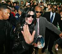 Pop star Michael Jackson waves to fans at Narita International Airport on Sunday. | AP PHOTO