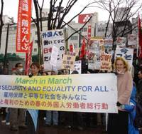 Workers in Japan from around the world march Sunday through Tokyo's Shibuya Ward to call attention to deteriorating job conditions in Japan, especially for foreigners. | RICHARD SMART PHOTO