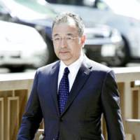 Livedoor President Kozo Hiramatsu enters the Tokyo District Court on Friday. | KYODO PHOTO