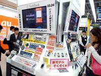 Customers peruse new mobile phones at the Bic Camera in Tokyo's Yurakucho district last October. | YOSHIAKI MIURA PHOTO