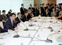 Prime Minister Shinzo Abe speaks Friday during the first meeting of a government panel tasked with discussing the current ban on 'collective self-defense,' in Tokyo. | KYODO PHOTO
