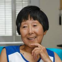 Toshiko D'Elia, 77, among the top runners in her age group in world competitions, is interviewed recently at her home in Ridgewood, N.J. | KYODO PHOTO