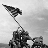 U.S. Marines of the 28th Regiment, 5th Division, raise the American flag atop Mount Suribachi on Feb. 23, 1945, during the Battle of Iwojima. The island was renamed Iwoto last week. | AP PHOTO