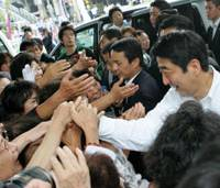 Prime Minister Shinzo Abe is greeted by supporters in Tokyo on Thursday as he kicks off the Liberal Democratic Party's campaign for the House of Councilors election. | AP PHOTO