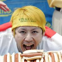 Takeru Kobayashi opens wide after winning the 2006 International July Fourth Hot Dog Eating Contest in Coney Island. The six-time champ was beat this year by American Joey Chestnut. | AP PHOTO